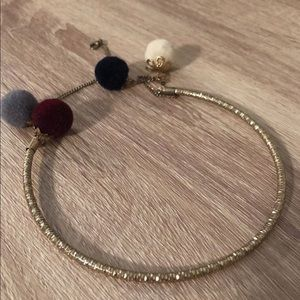 Gold choker with Pom poms